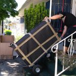 Movers Burnaby Signature Moving moving a dresser down the stairs