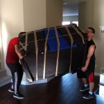 burnaby movers Signature Moving maneuvering a couch