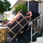 movers burnaby Signature Moving handling a heavy dresser