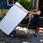 movers burnaby Signature Moving moving a fridge